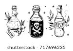 bottles with potions. poison... | Shutterstock .eps vector #717696235