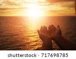 human hands open palm up... | Shutterstock . vector #717698785