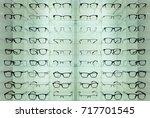 eyeglasses and sunglasses on... | Shutterstock . vector #717701545