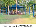 sun shade playground at grassy... | Shutterstock . vector #717702691