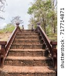 Small photo of Old laterite staircase with the metal banister to the top of the hill in the historical park.