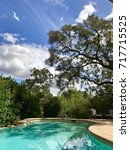 Small photo of EL DORADO HILLS, CA, USA - SEP 18, 2017: Interior or luxurious custom meridian home in the most affluent neighborhood of Sacramento area. Backyard Pool Area.