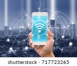 holding smart phone showing the ... | Shutterstock . vector #717723265