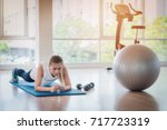 blurred woman are planking on... | Shutterstock . vector #717723319