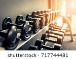 rows of dumbbells in the gym... | Shutterstock . vector #717744481
