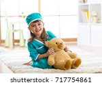 smiling kid girl pretending she ... | Shutterstock . vector #717754861