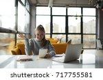 cheerful attractive female... | Shutterstock . vector #717755581