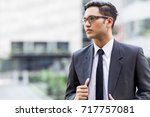 asian officer thinking about...   Shutterstock . vector #717757081