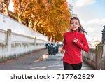 woman running in autumn fall... | Shutterstock . vector #717762829