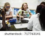 group of school girls learning... | Shutterstock . vector #717763141