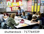 group of students learning in... | Shutterstock . vector #717764539