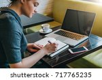 side view. young businesswoman... | Shutterstock . vector #717765235