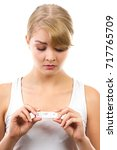 unhappy worried woman showing... | Shutterstock . vector #717765709