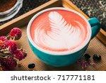beautiful red velvet caffe latte | Shutterstock . vector #717771181