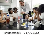 kindergarten students learning... | Shutterstock . vector #717773665