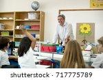 teacher teaching flower... | Shutterstock . vector #717775789
