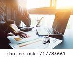 accountant using a calculator... | Shutterstock . vector #717786661