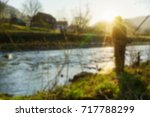 fishing on the river blurred... | Shutterstock . vector #717788299
