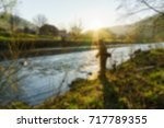 fishing on the river blurred... | Shutterstock . vector #717789355