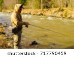 trout fishing in the mountain... | Shutterstock . vector #717790459