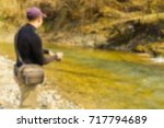 trout fishing in a mountain... | Shutterstock . vector #717794689