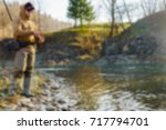 fishing on the river blurred... | Shutterstock . vector #717794701