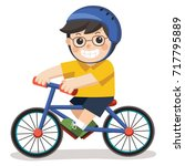 a cute boy with glasses. he... | Shutterstock .eps vector #717795889
