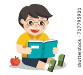 a cute boy with glasses. he... | Shutterstock .eps vector #717795931