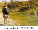 trout fishing in a mountain... | Shutterstock . vector #717797305