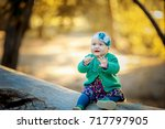 little baby in the autumn forest | Shutterstock . vector #717797905