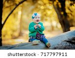 little baby in the autumn forest | Shutterstock . vector #717797911