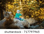little baby in the autumn forest | Shutterstock . vector #717797965