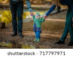 little baby learns to walk ... | Shutterstock . vector #717797971
