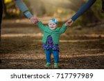 little baby learns to walk ... | Shutterstock . vector #717797989
