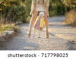 little baby learns to walk ... | Shutterstock . vector #717798025