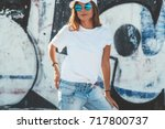 model wearing plain white... | Shutterstock . vector #717800737