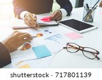 business advisor analyzing... | Shutterstock . vector #717801139
