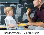 cute little boy at speech... | Shutterstock . vector #717806545