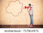 child pretend to be businessman....   Shutterstock . vector #717813571