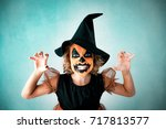 funny child dressed witch... | Shutterstock . vector #717813577