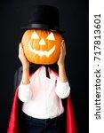funny child dressed halloween... | Shutterstock . vector #717813601