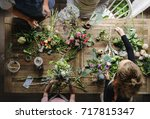 florist making fresh flowers... | Shutterstock . vector #717815347