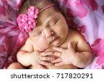 newborn baby sleeping in a... | Shutterstock . vector #717820291
