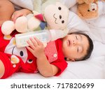 baby asia sleepping with her... | Shutterstock . vector #717820699