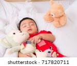 baby asia sleepping with her... | Shutterstock . vector #717820711