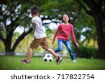 asian boy and girl enjoying... | Shutterstock . vector #717822754