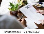 hands holding wedding planner...   Shutterstock . vector #717826669