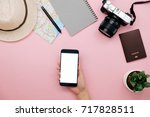 hand of woman using smart phone ... | Shutterstock . vector #717828511
