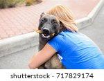 female volunteer with homeless... | Shutterstock . vector #717829174