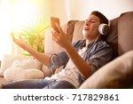 happy teenage singing and... | Shutterstock . vector #717829861